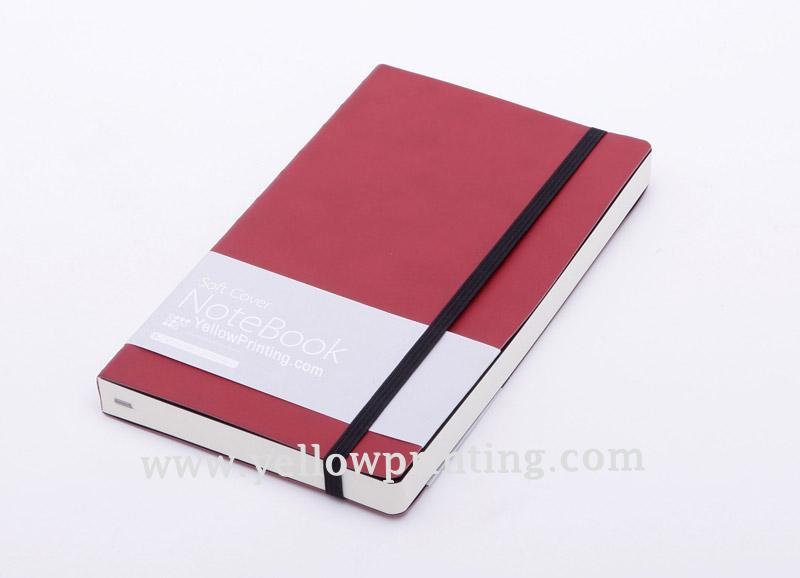 Paper back notebook with elastic band